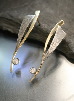 Bezel set Diamond earrings with Mokume Gane (14KW and Sterling Silver combination) accents on forged 14KY stems.