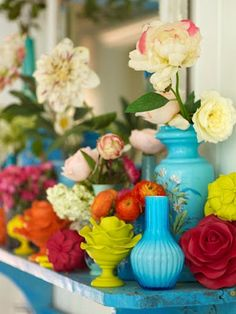 Love, love the bright colors. I should do this for my kitchen.... Brightly painted candlesticks and vases! Genius idea! :)