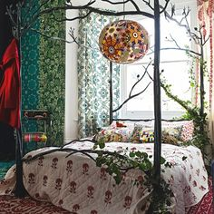 Woodland bedroom with iron four-poster bed