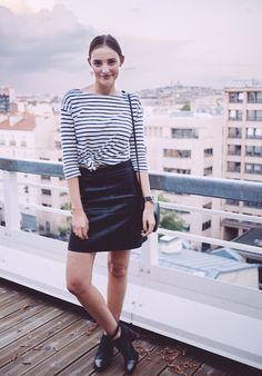 Pair a striped shirt with a black skirt for a night out.