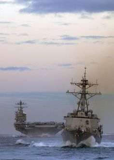 The Arleigh Burke class guided missile destroyer USS Shoup DDG-86 and USS Abraham Lincoln CVN-72.