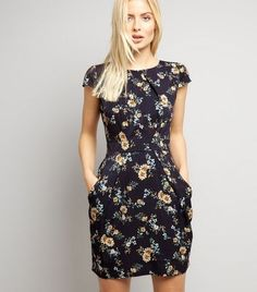 """Blue Vanilla. Inject some spring florals into your wardrobe this season. Pair this dress with heels to elevate the look.- Rounded neckline- Fit and flare design- Simple short sleeves- All over floral print- Mini length- Casual fit that is true to size- Margaux is 5'8.5""""/174cm and wears UK 10/EU 38/US 6"""