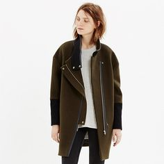 This sleek sculptural coat gives a laid-back nod to biker style (see: stand-up collar and zips on the sleeves) while being completely now. An update on a timeless cocoon shape in a versatile colorblock, this design-team favorite is one to layer over sweaters and dresses alike—the covered asymmetrical zip will keep things cozy.