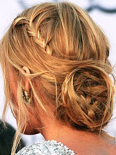 Make 3 braids (either side of head and nape of neck).  Wrap braids together into a loose know at back of head.  Pull out stray pieces.