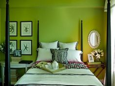 black+and+green+bedroom | There's a comfy chair to lounge after a long day at the beach.