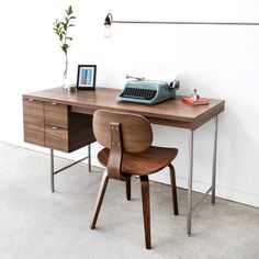 Gus* Modern | The Conrad Desk is a compact home office desk with a strong Mid-Century pedigree. All surfaces are finished in walnut, to contrast the slender, tubular stainless steel legs and drawer pulls. The main drawer is designed to hold hanging file folders, and the two smaller drawers are perfect for organizing stationary and supplies. This desk evokes the style of 1950s Modernism, but with a scale and functionality suited perfectly for today.