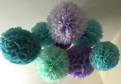 Make these fun tissue pom part of your world!! This set includes: 4 large (18 diameter) poms 3 Medium (14 diameter) poms 3 Small (9 diameter) poms 10 yards of monofilament step by step instructions for blossoming  Poms pictured are: Aqua, Carribean Teal, Mist, Orchid, Lavender, Mint Colors can be assigned per your discretion...please just leave your preference at checkout. Poms are made of 100% recycled, high quality tissue paper. They will arrive to you folded, pre-cut and wired to hang…
