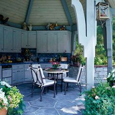 Built for Entertaining              This fully operational kitchen was built inside an open-air gazebo. Solid walls on two sides protect the appliances from the elements; the remaining four sides of this hexagonal structure are open so that both cooks and guests can easily move throughout the space