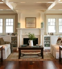 Built ins, fireplace and ceiling treatment