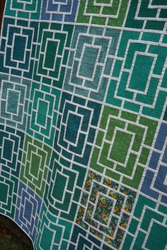 Peek quilt and pattern by Melanie Tuazon. Shades of jade, emerald, teal, and blue from collections by Carolyn Friedlander, Cotton + Steel, and Kona Cotton.