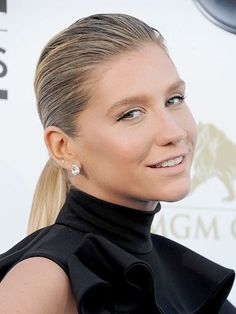 Kesha with a slicked back ponytail and natural makeup at the Billboard Music Awards in 2013 | allure.com
