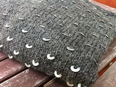 washers in a hand knit sweater.  brilliant idea!