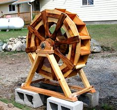 The RunnerDuck Waterwheel plan, is step by step instructions on how to build a decorative waterwheel.
