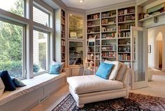 Traditional Library with Window seat, Bookshelf ladder, French doors, Built-in bookshelf, Crown molding, Carpet