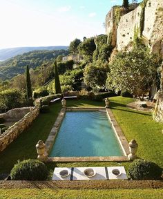 One of the Most spectacular Pools in the world in Provence- such a Beautiful setting, but also the Pool itself- those Four urns!!! @horschinteriors #summerinfrance #poolsidewithhorschinteriors #provence #fromourpinterestboard #urns #perfection #mykindofgarden #thesouthoffrance