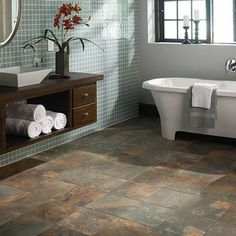 This tile collection from American Olean's Kendal  looks like slate but has the easy care and water resistance that only porcelain can offer. This tile flooring offers a rustic natural look that has a wide range of color variations, that's why we love it!