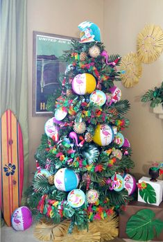 A fun colorful Luau Santa Christmas Tree. If you love tropical vibes, you'll love love this tropical Christmas tree with mostly DIY ornaments. Tropical Christmas Trees, Summer Christmas, Unique Christmas Trees, Holiday Tree, Xmas Tree, Christmas Holidays, Hawaiian Christmas Tree, Prim Christmas, Christmas Tree Inspiration