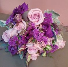 maid of honor bouquet of lavender roses, purple lisianthus, purple statice, wax flower, and dusty miller