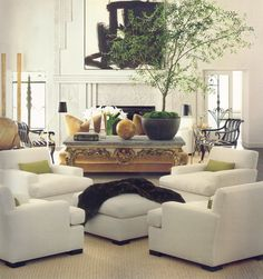 white. Have always preferred angling furnishings in the center of the room to lining up along the perimeter.
