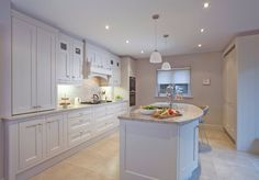 Pemberton From our Ailesbury Collection, this hand made inframe kitchen has been hand painted in Farrow and Ball 'Skimming Stone.'   Photography by Derek Robinson URL http://www.noeldempsey.com Category Kitchen  Style Contemporary  Location Dublin