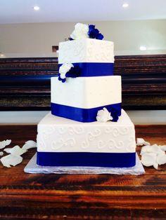 Wedding cake... Blue ribbon... White flowers.