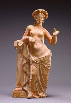 Aphrodite  Greek, Tanagra, 250 - 200 B.C.   Terracotta with polychromy   H: 10 11/16 in.   55.AD.7