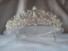 Handmade swarovski wedding tiara Adrienne set on a silver band also available in gold roughly 1 1/2  tall ,this tiara is made using clear crystals clear pear and navette diamante stones ivory/white pearls ,a stunning tiara lots of sparkle and , also,shown in the pictures with the matching jewellery also available in my shop .