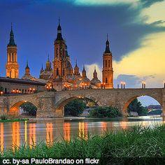 Google Image Result for http://indietravelpodcast.com/wp-content/uploads/basilica-church-zaragoza-spain-bridge-river-square.jpg