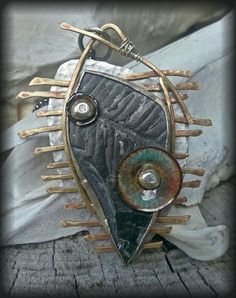Unearthed Fossil Pendant by beadkeepers on Etsy