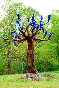 Amazing Bottle Tree (more than 8 feet tall) made by Micah.  -  purpleflamingo.org