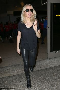 All black everything! Ellie Goulding looked like a bona fide rock chick as she touched dow...