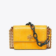285fa3f14383 Michael Kors Yasmeen Metallic Gold Snakeskin Leather Clutch - Tradesy. See  more. Tory Burch Kira Snake Double-strap Mini Daisy Snakeskin Shoulder Bag  ...