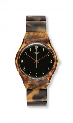 ECAILLE is a lightweight watch that has a classic tortoise shell design that's sure to become your favorite accessory. ECAILLE features a flex band so it's easy to put on or take off. Dress it up or down, it's perfect year round.