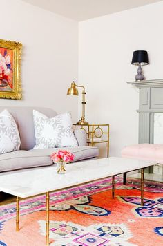 Neutral living space with small vase of roses and gold details