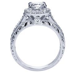 Victorian Halo Engagement Ring- the band is gorgeous on this ring. Reminds me of the first anniversary ring I have!
