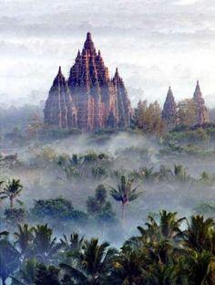 In the mist - prambanan hindu temple complex, java, indonesia