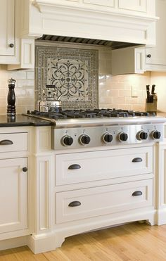Custom made cabinet with patterned backsplash