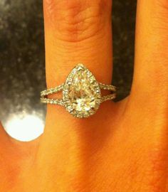 Her engagement ring, halo tear drop/pear gorgeousness of a ring
