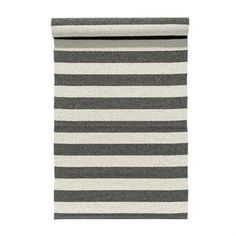 This Uni rug in charcoal grey from Nordic Nest is ideal for anyone who wants a plastic rug with a classic, timeless design. Uni has lovely stripes in white and a dark warm grey color and is easy to place in the most homes. It's very durable and easy to clean which makes it ultimate for the kitchen, hallway and other exposed surfaces. Available in different sizes.