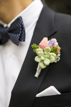 A polka dot bow tie and succulent boutonniere add whimsy to the groom's look. Wedding Planner: SoCal Wedding Consultant.