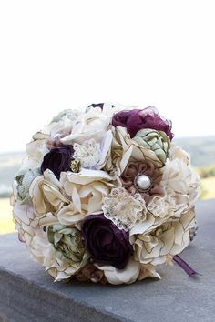 handmade floral bouquet, directions are here  http://www.weddingbee.com/2010/07/27/diy-fabric-flower-bouquet/