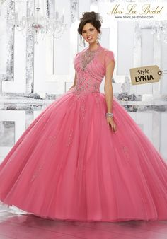 Style LYNIARhinestone and Crystal Beaded Bodice on Tulle Ball Gown Skirt with Beaded AppliquésPrincess Perfect, This Tulle Quinceañera Ballgown with Beaded Skirt Features an Intricately Beaded Bodice and Illusion Neckline. Keyhole Corset Back. Matching Bolero Jacket Included. Colors Available: Blush, Capri, Guava, White.