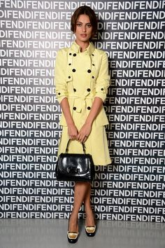 Look to Catrinel Marlon's lemon yellow trench coat for lessons in how to wear your trench as a dress and how to incorporate pastel hues into your Fall wardrobe.