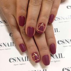 Best Metallic Nail Art and Manis for Brides: A Scarlet Red Manicure with a Geometric Gold Detail on the Ring Finger Nail