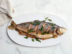 If you've ever shied away from serving whole fish, now is the time to give it a try and impress your guests at your next dinner party. Food Network Kitchen's foolproof Herb-Stuffed Roast Arctic Char recipe takes the worry out of the process.