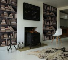 Vintage looking faux bookshelf wallpaper by Studiomold
