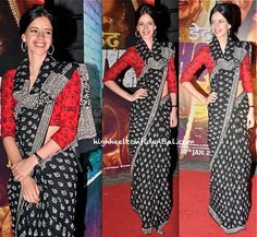 For the premiere of a recent movie, Kalki picked what looked like a cotton sari paired with a quirky printed blouse. Is the sari-drape a deal-breaker for you? Though am mostly a purist when it comes to sari drapes, much to my surprise there's something about this look that I like. Maybe because Kalki looks completely unaffected and adorable?