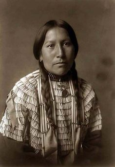 Native American Woman -  You are looking at an intriguing picture of the Daughter of American Horse. It was taken in 1908 by Edward S. Curtis.    The picture presents a Half-length portrait, facing right. The woman is wearing a traditional Indian Dress with beads    We have created this collection of pictures primarily to serve as an easy to access educational tool.