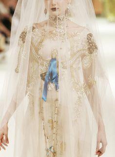 royal-esque. blue ribbon, white and gold wedding dress. bridal couture. bridal fashion. bride. princess bride. dark lipstick.
