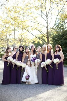 Love that the maid of honors have grey dresses and the rest of the bridesmaids have purple dresses